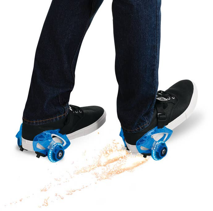 blue razor heel wheels on a person's shoes