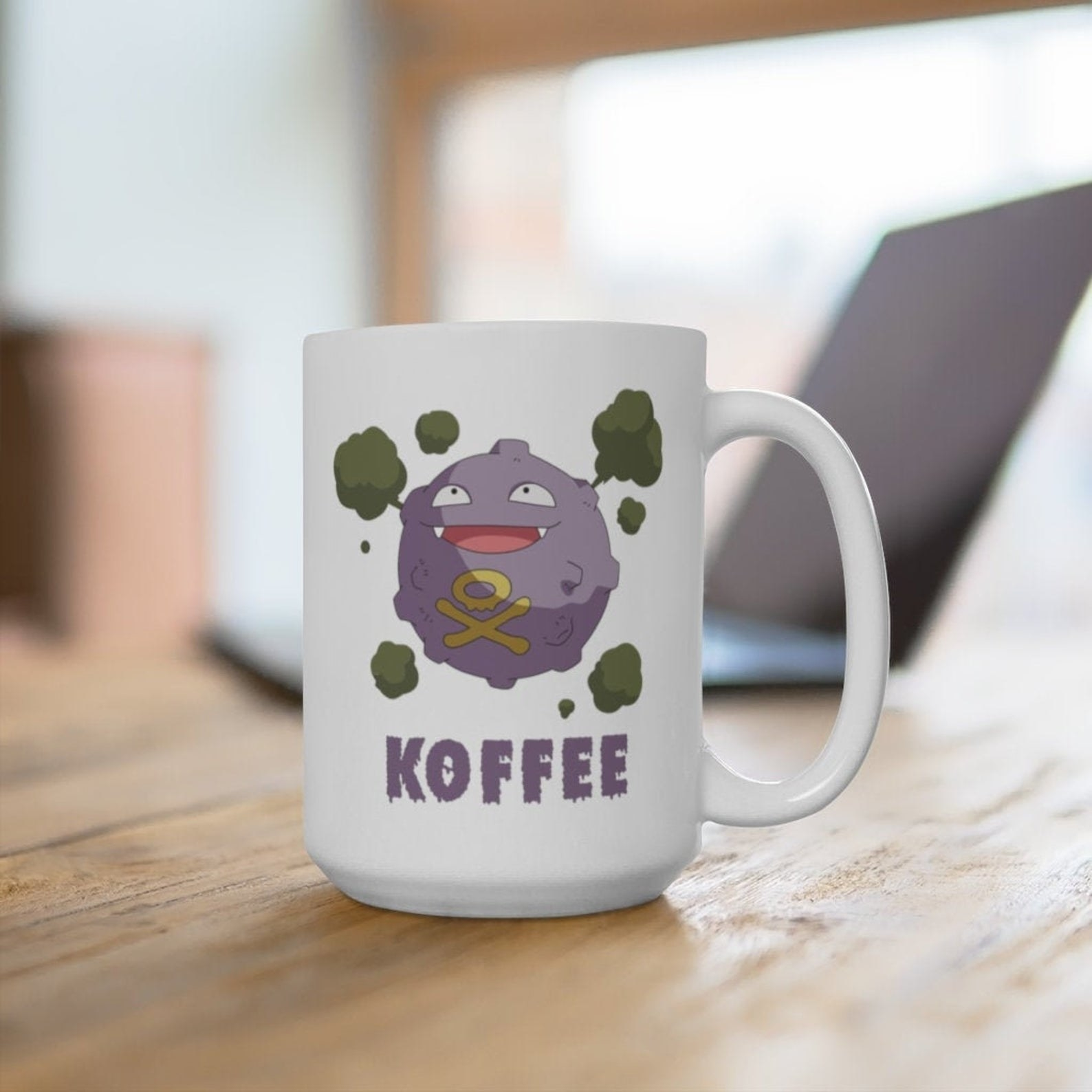 """a white mug with a koffing pokemon on it and the word """"koffee"""""""