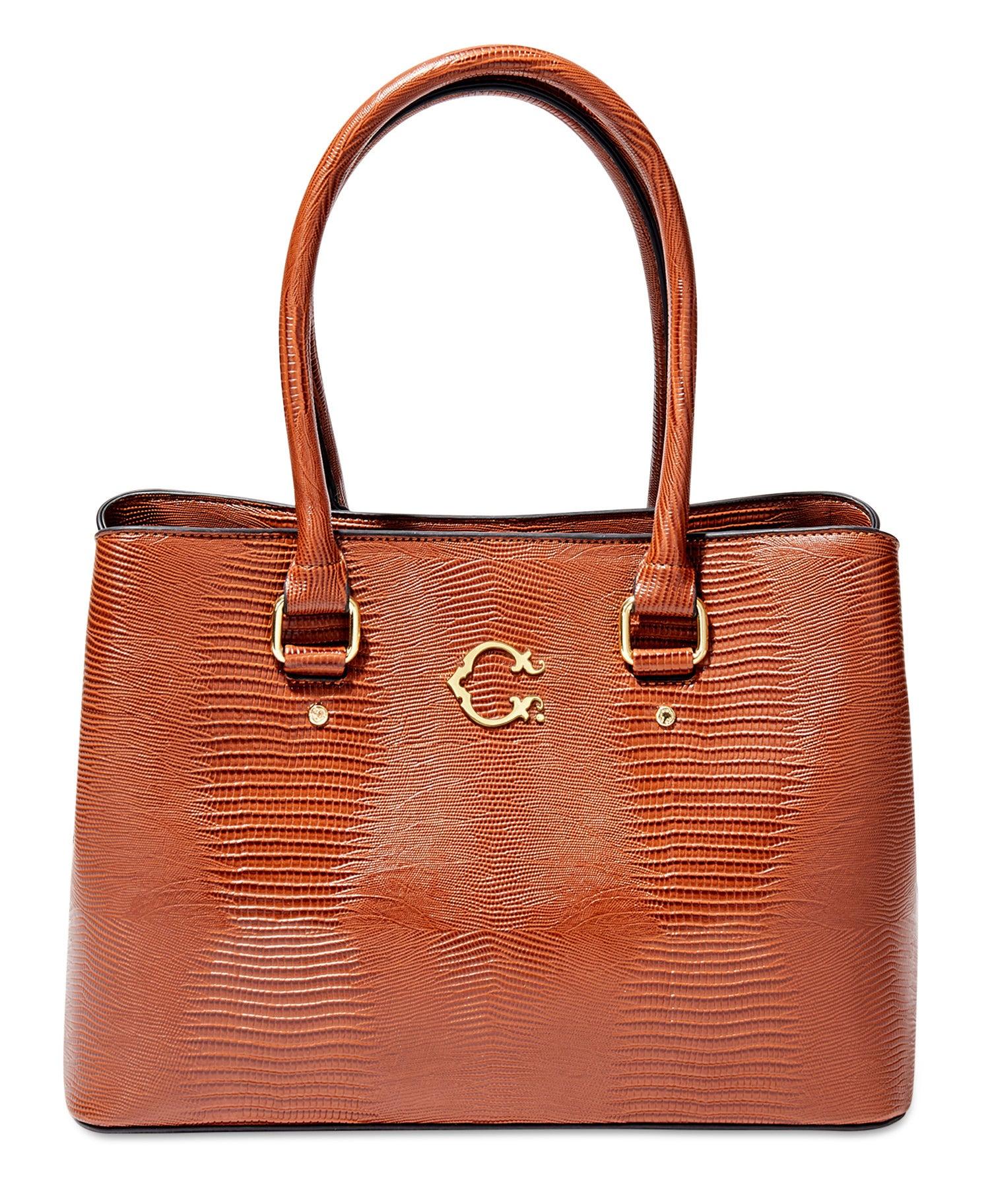 orange tote bag in a faux lizard skin pattern