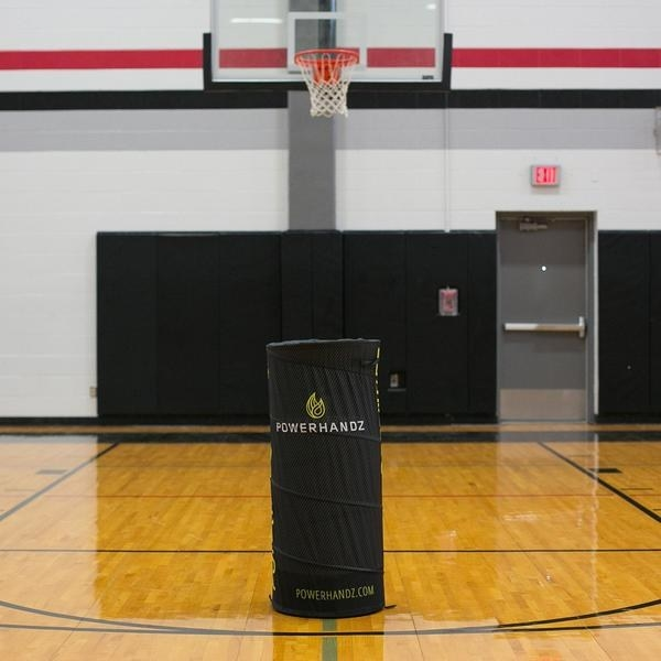Black pop-up defender in the middle of a basketball court