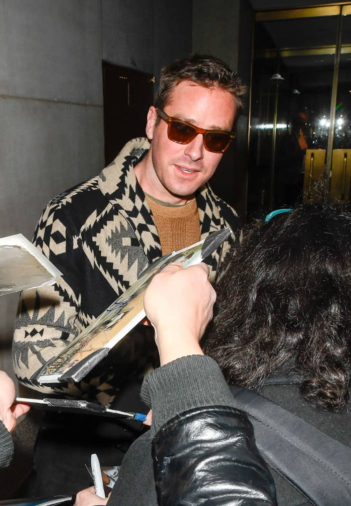 Hammer signs autographs while wearing a jacket, a sweater, and sunglasses outside the Today Show in New York City on March 9, 2020