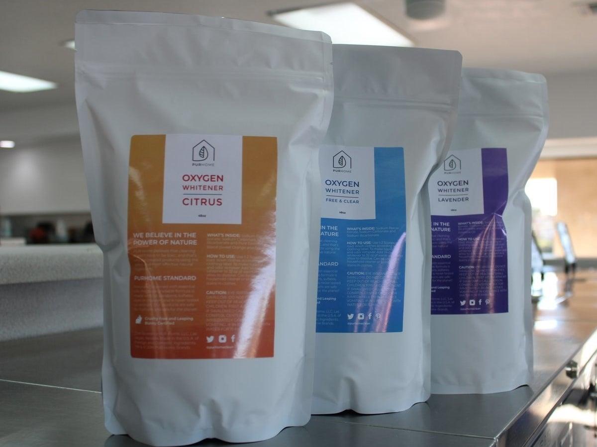 Three packs of different-scented liquid whitening detergent