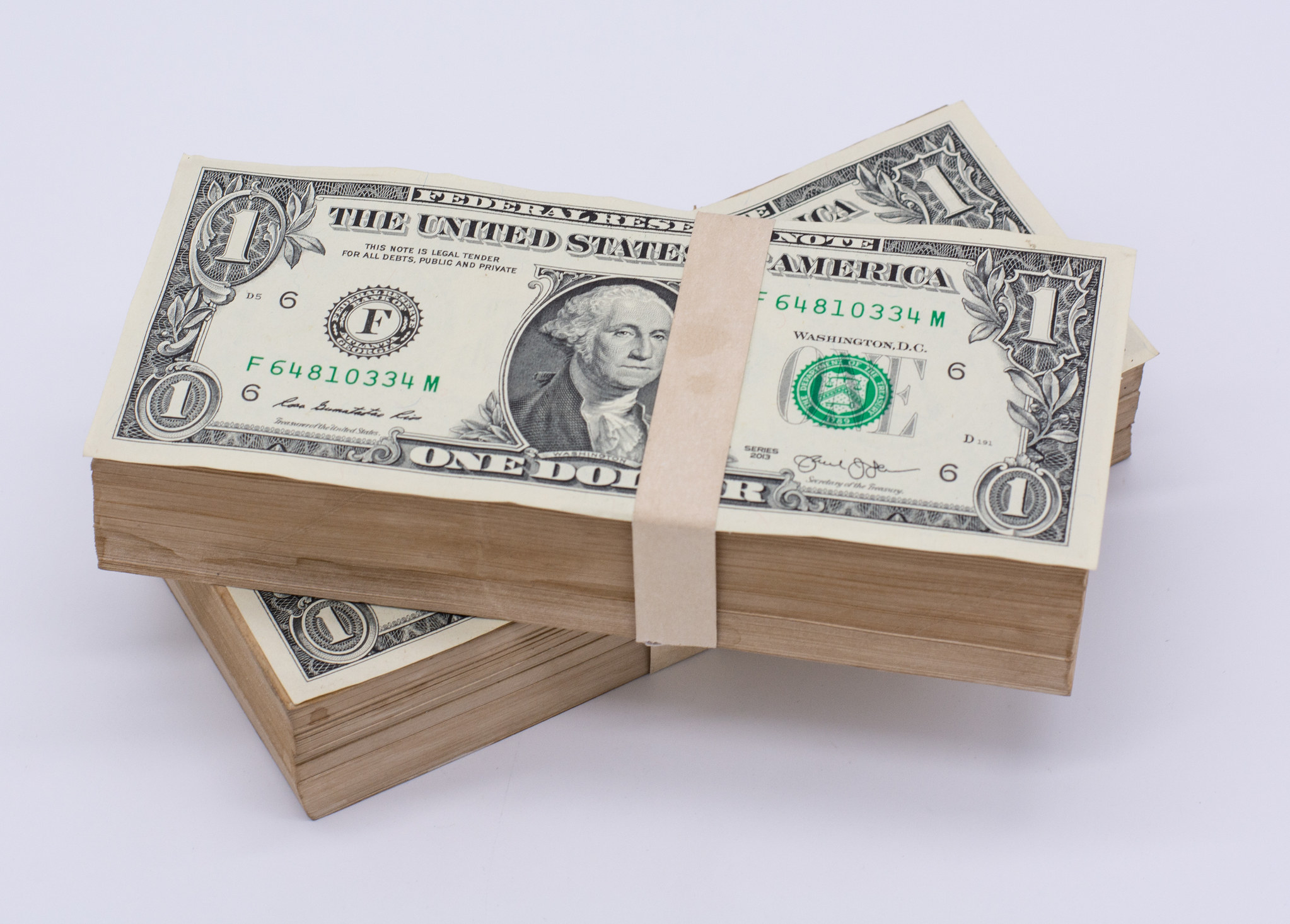 A thick stack of dollar bills