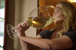 Amy Schumer drinking wine
