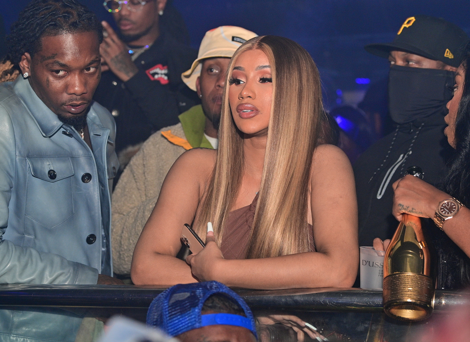 Cardi B sits at the bar alongside Offset at the Offset Birthday Celebration as their surrounded by a crowd of people