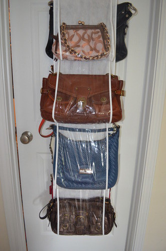 The organizer hanging over the door storing multiple purses