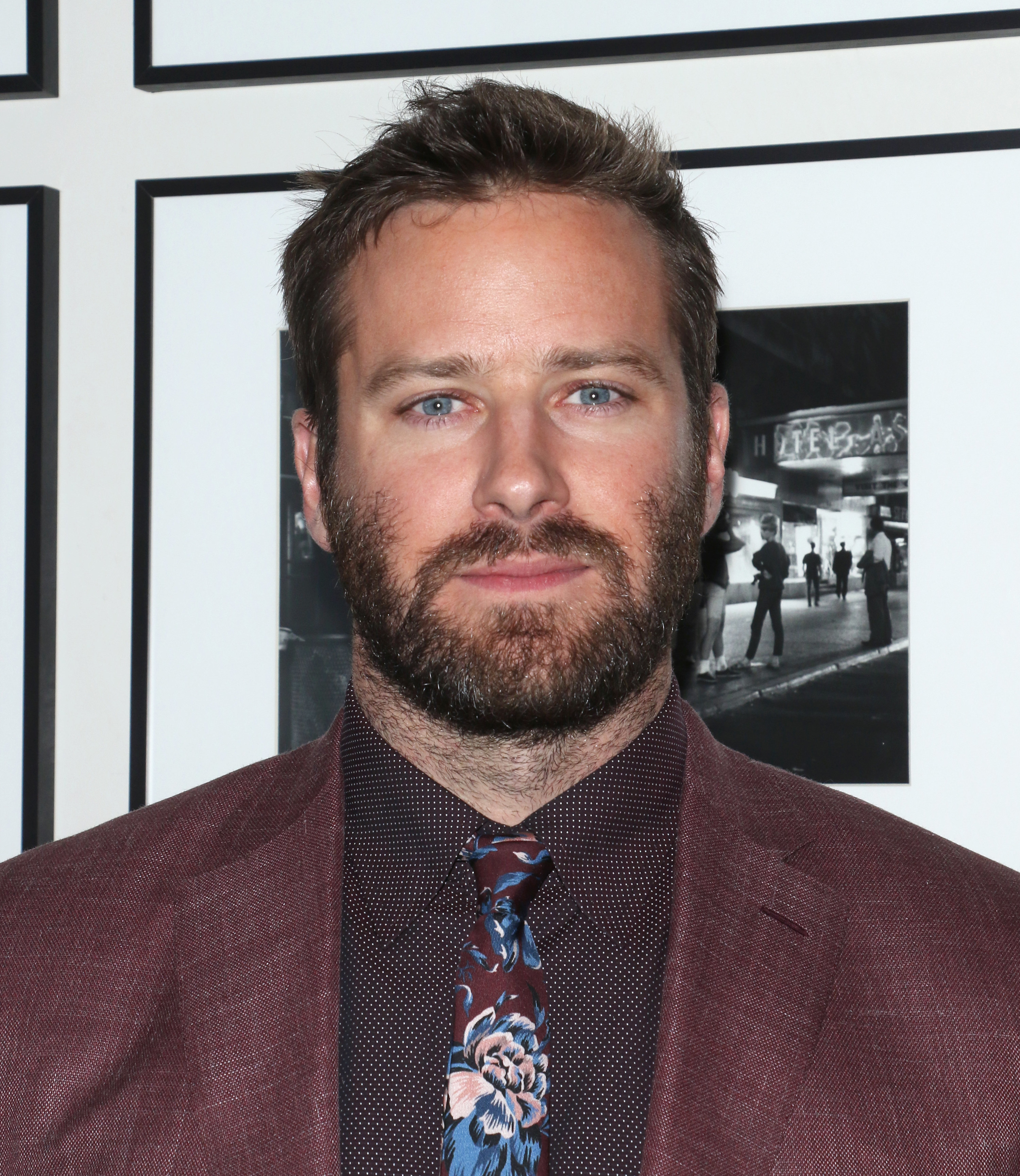 Hammer wears a suit with a patterned button-down and tie at the New York screening afterparty for Hotel Mumbai