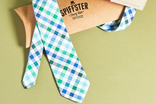 a blue. green, and white checkered tie