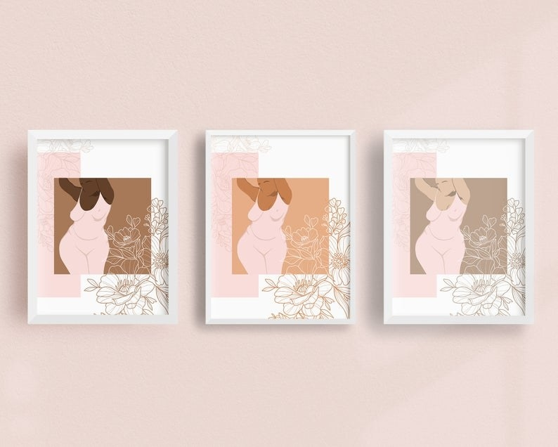 three art prints with a curvy, plus-size person presenting as female with pink and gold floral print surrounding it. Each print is the same except in a different shade of brown
