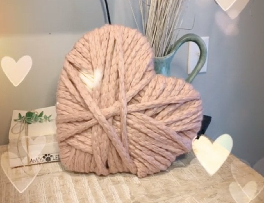 A heart made of layered, thick pink yarn