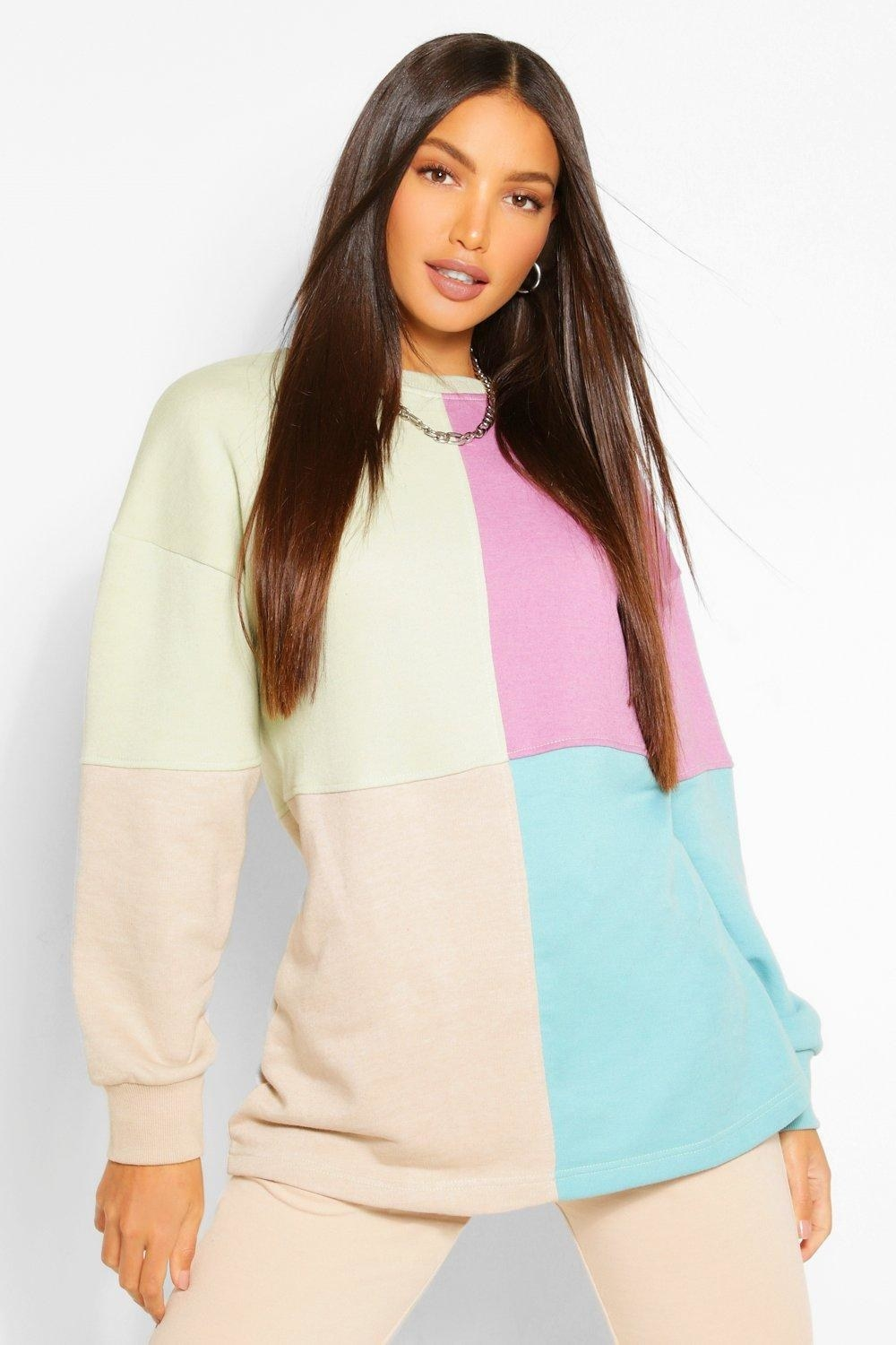 a model wearing the color block sweatshirt