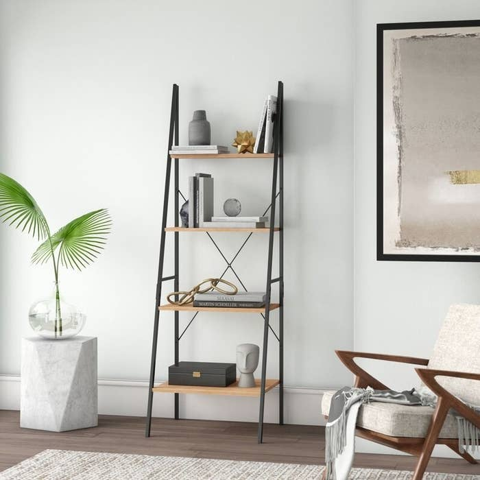Metal ladder bookcase with natural wood finish