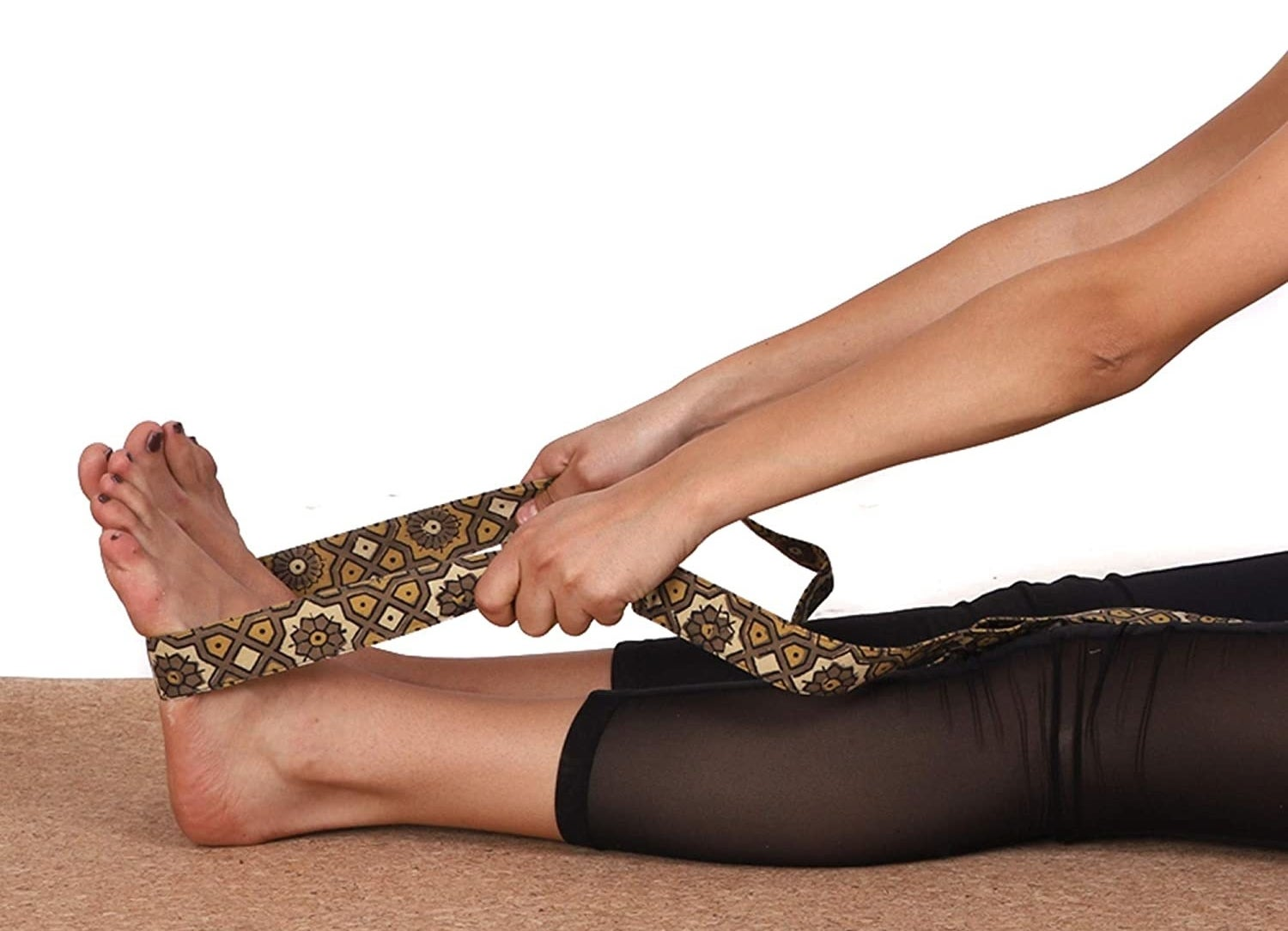 A model using the block-printed strap to stretch her legs