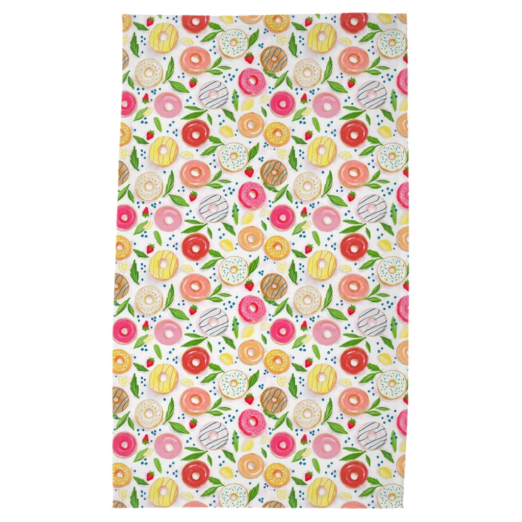 tea towel covered in doughnuts with small lemons and strawberries