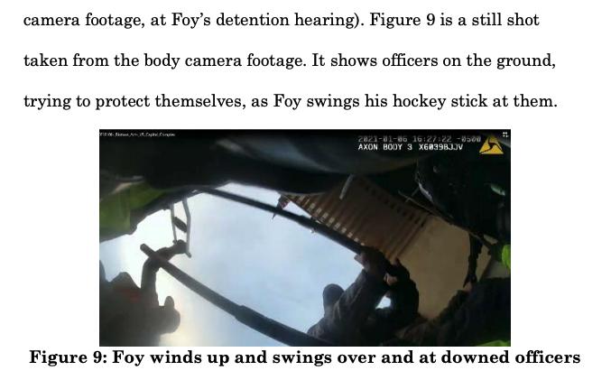 A man raises a hockey stick over a police officer's body camera