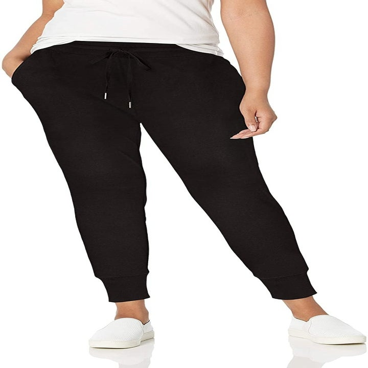 A model wearing the joggers in black