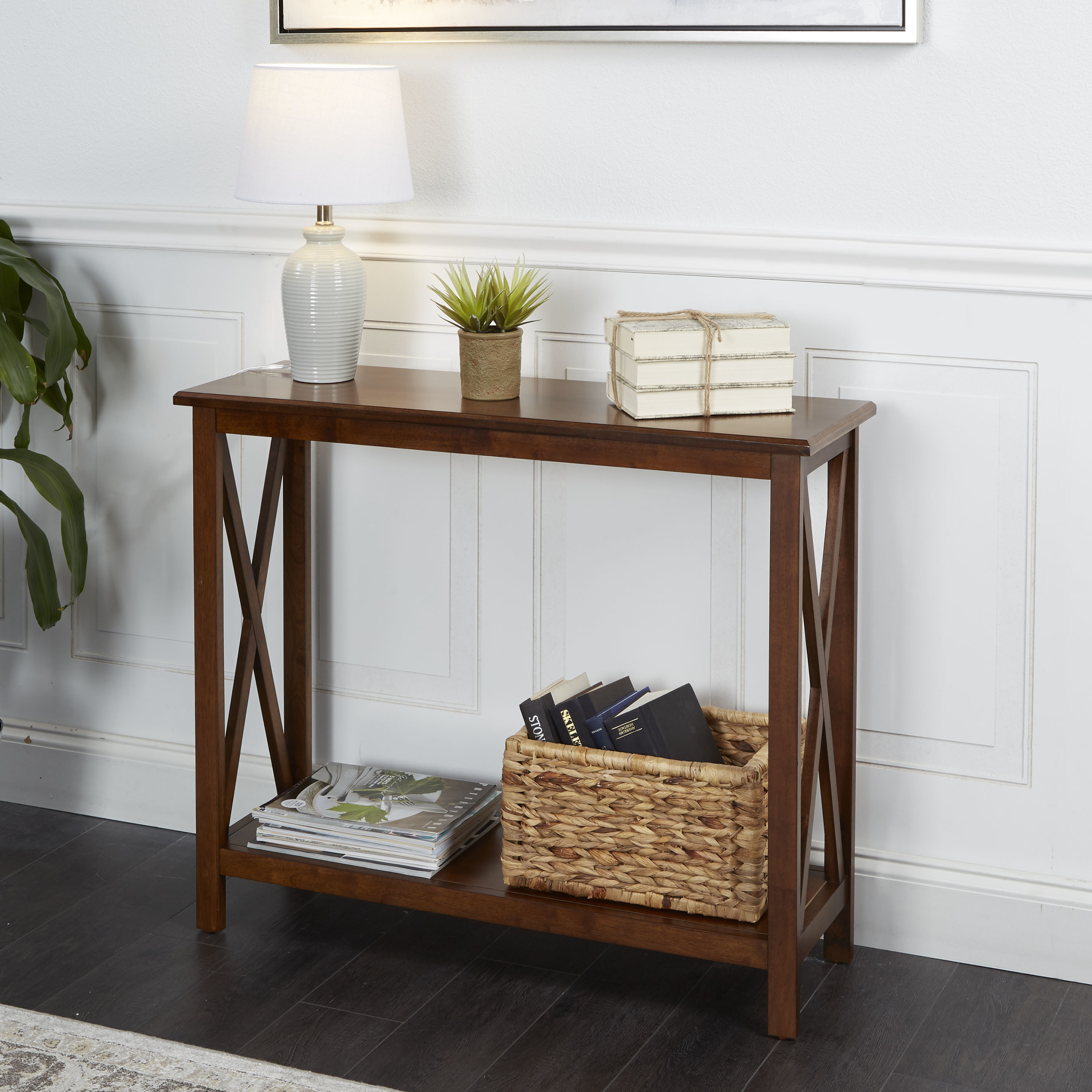 brown wooden console table with accessories on it