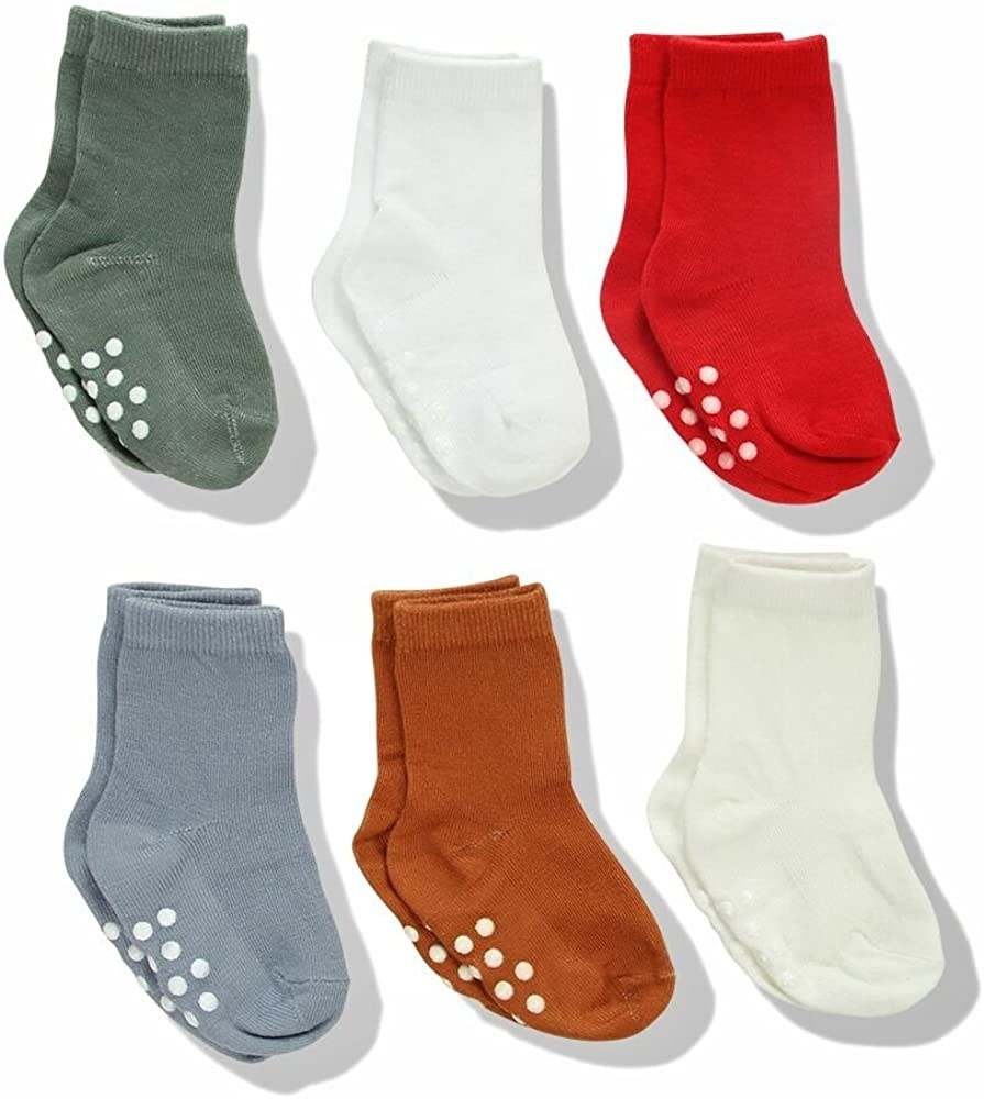 Several pairs of baby socks with grip dots on the bottoms
