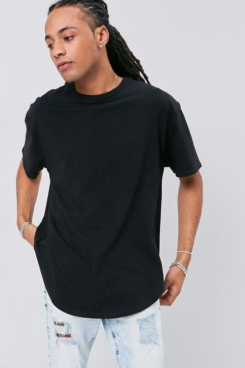 Person wearing crew neck shirt and jeans