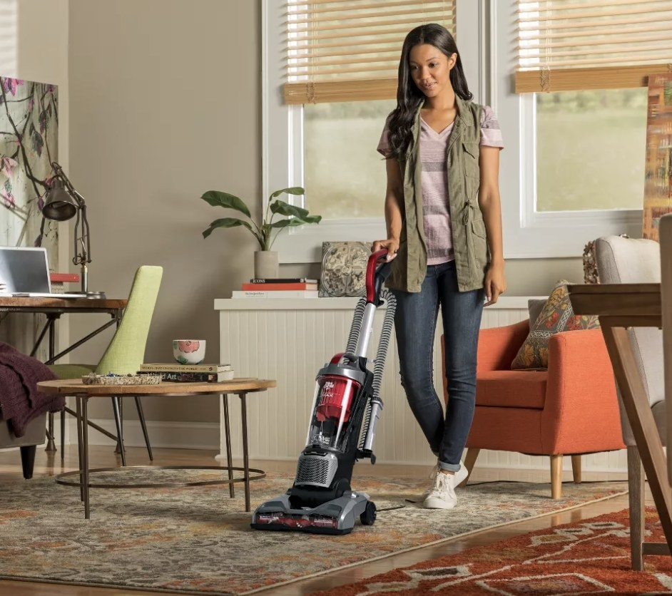 Person is using a vacuum