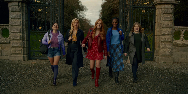 Musa, Stella, Bloom, Aisha, and Terra walking into Alfea