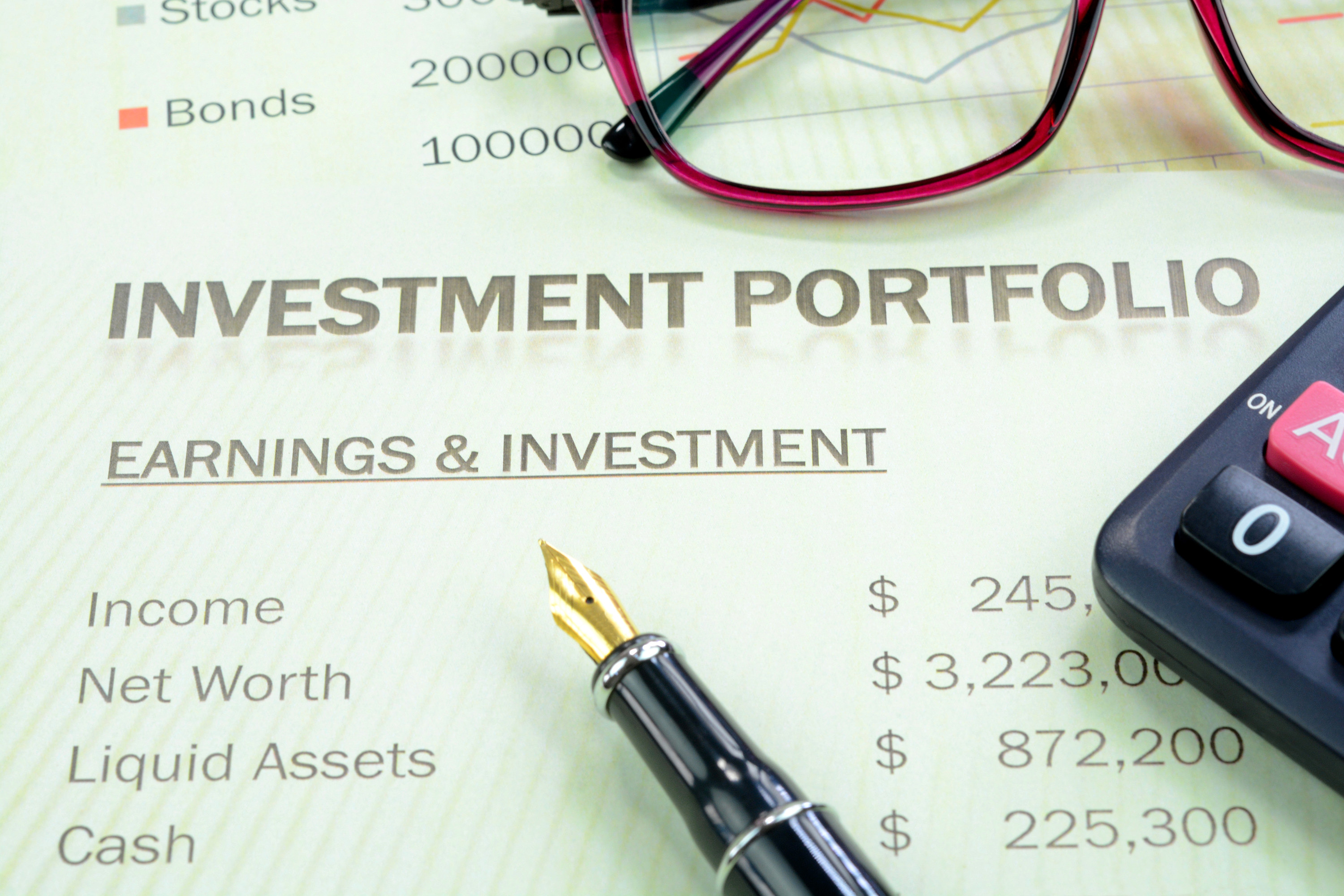 """Paper that says """"investment portfolio"""" and lists earnings and investments"""