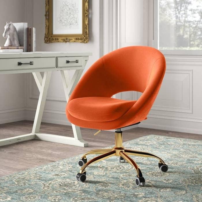 The velvet chair in orange