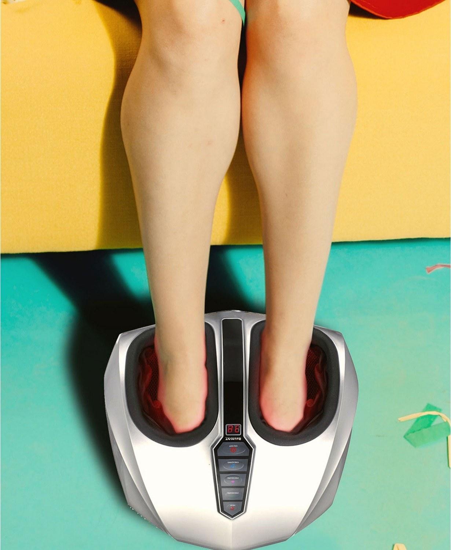 Feet in silver foot massager