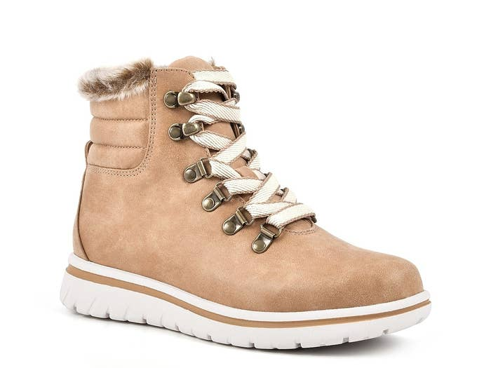 The lace-up boot with white tennis-shoe like sole in tan with faux fur around the ankle