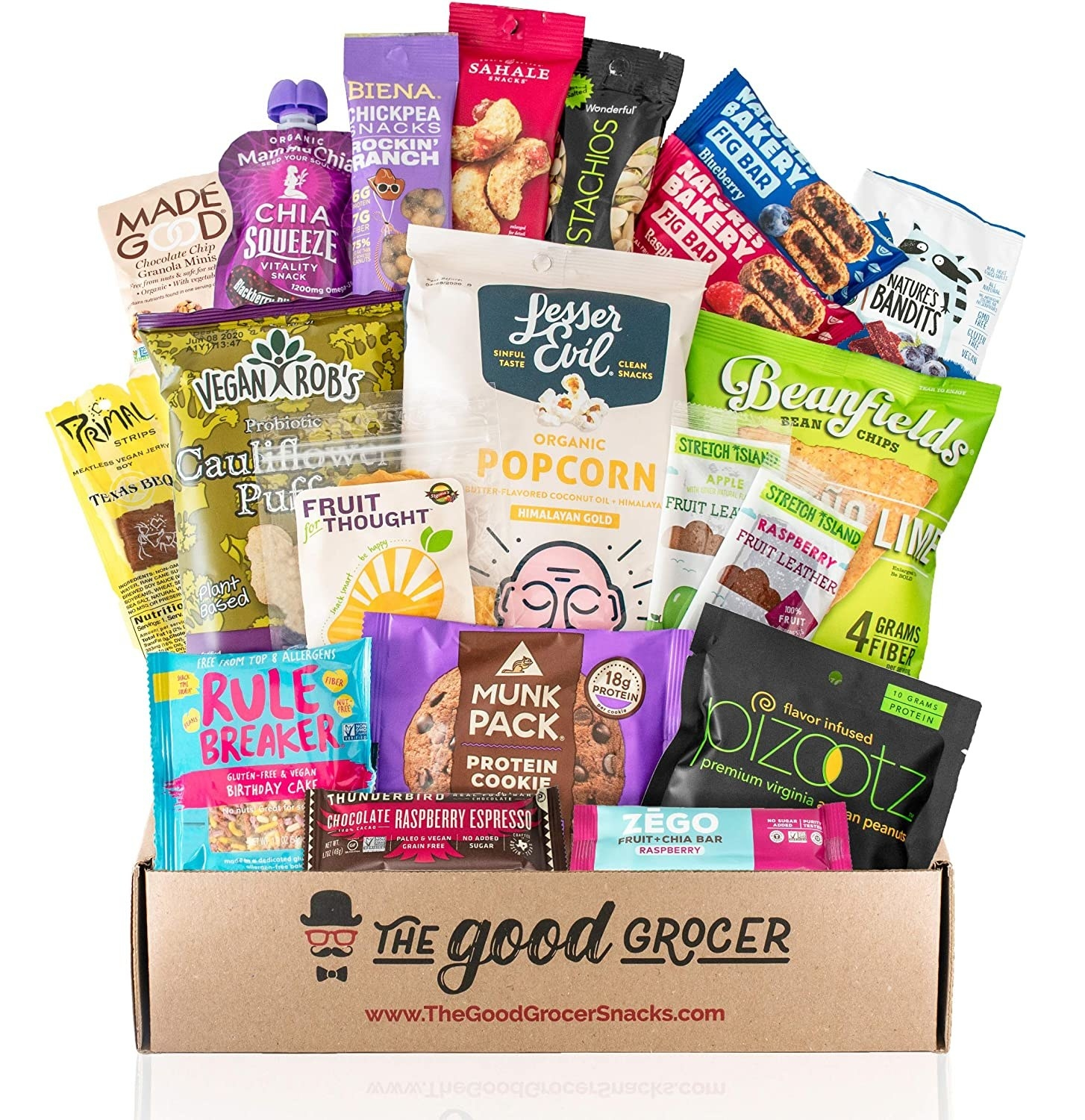 a box filled with vegan snacks like bean chips, fig bars, and cauliflower puffs
