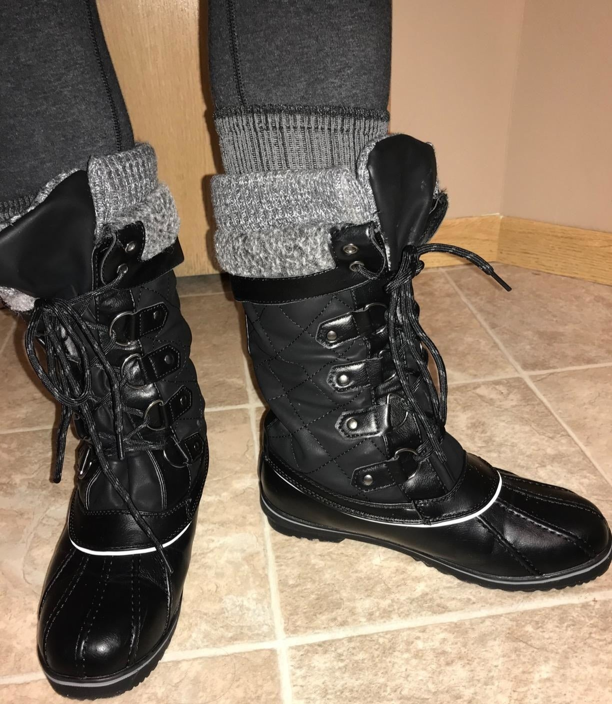 reviewer wearing the boots in black