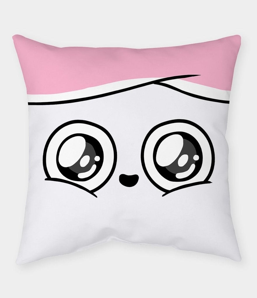 The pillow depicting a close-up of Cuppy's joyous face