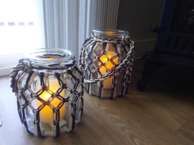 a reviewer's photo of the flameless candles inside a canister