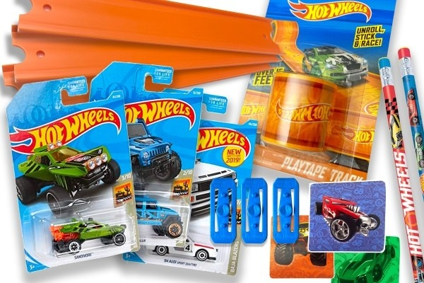 multiple Hot Wheels cars with race tracks, pencils, and other themed accessories