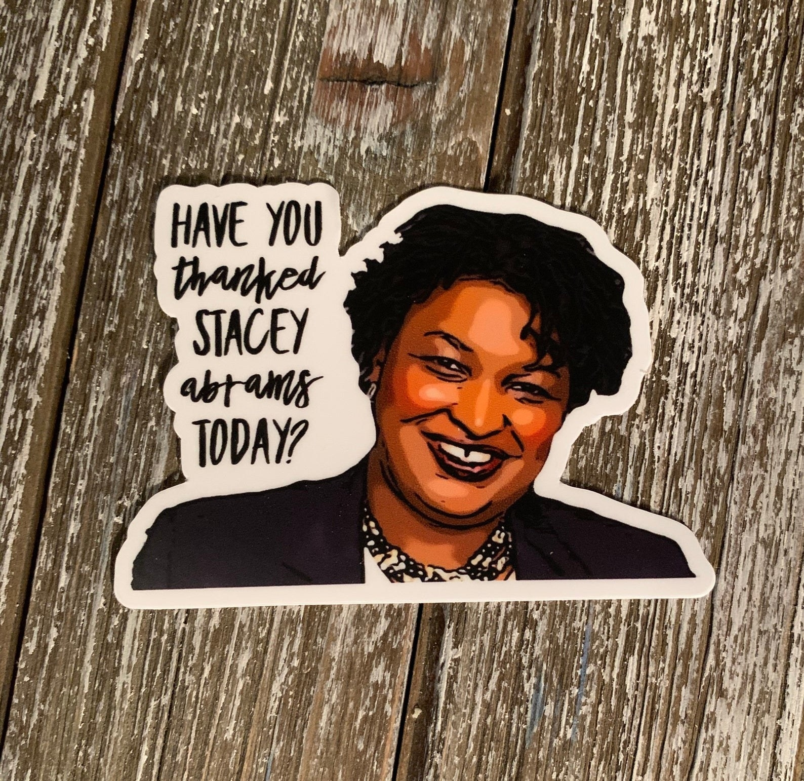 """sticker that says, """"Have you thanked Stacey Abrams today?"""" with her smiling face on it"""