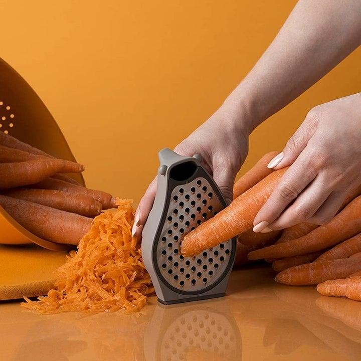 Hand grating carrots