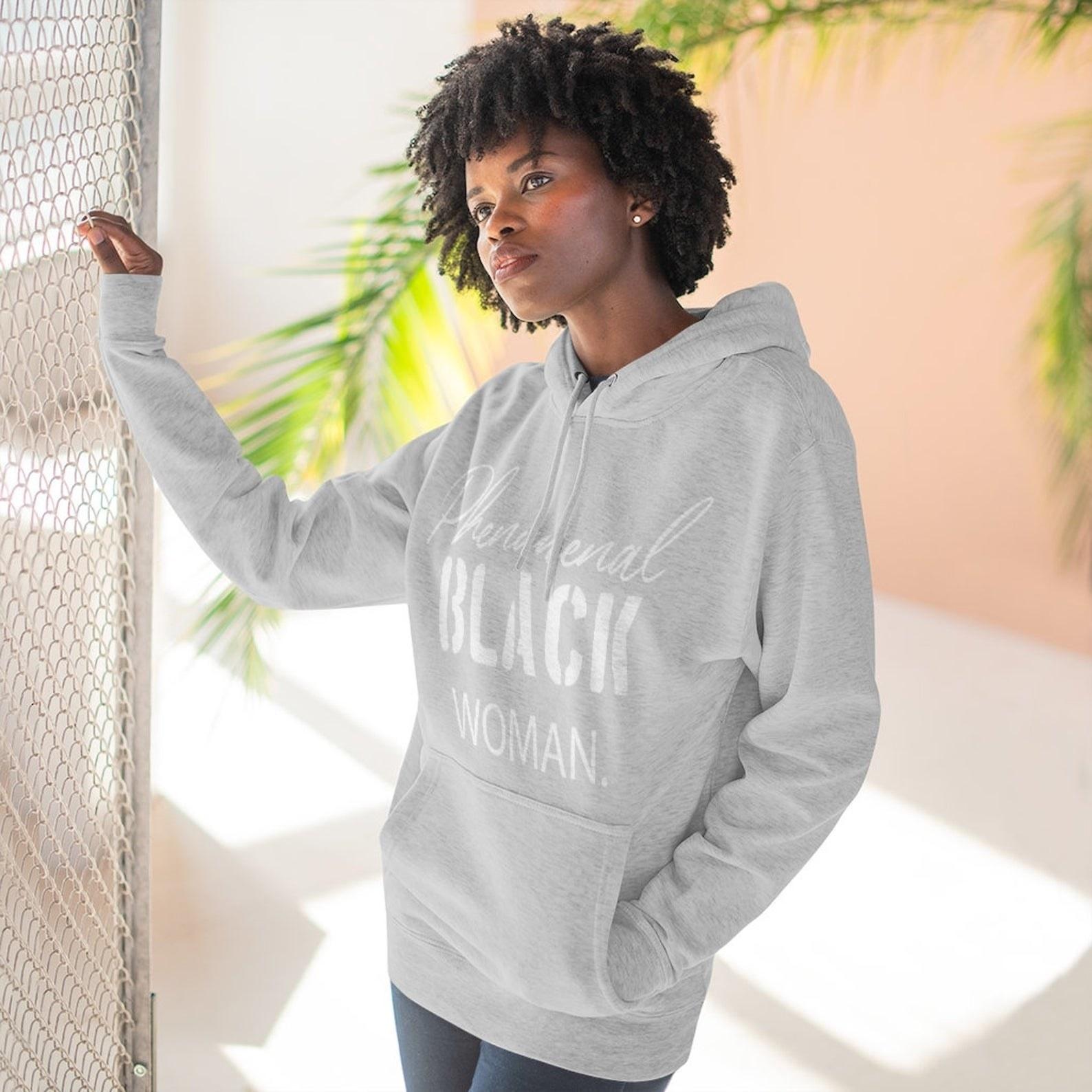 """woman wearing a gray hoodie that says, """"Phenomenal black woman"""""""