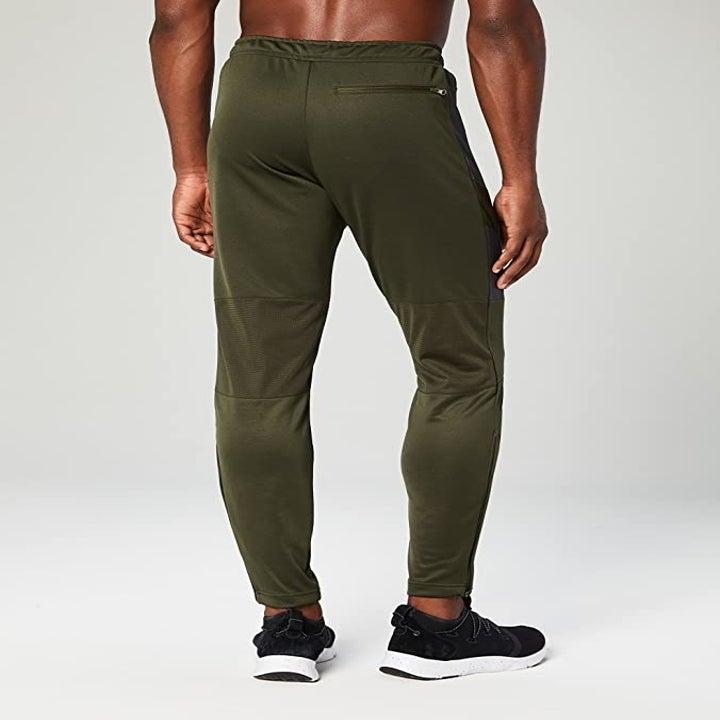 A model wearing the pants in grey