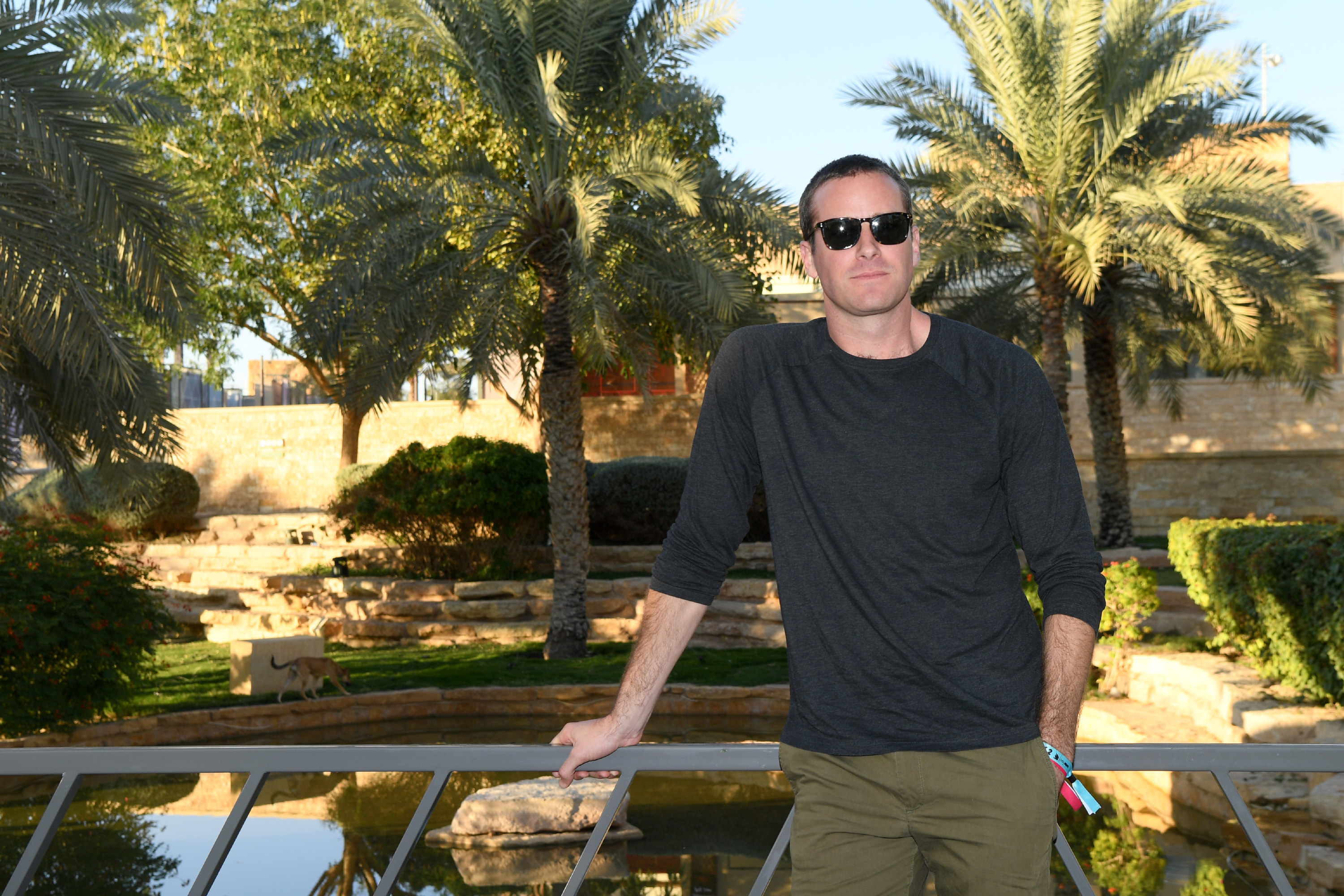 Armie Hammer in sunglasses, a gray long-sleeved shirt, and dark green pants at the MDL Beast Festival Lunch on December 21, 2019 in Riyadh, Saudi Arabia