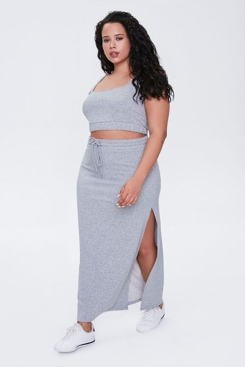 a model wearing the heathered gray drawstring skirt and matching top