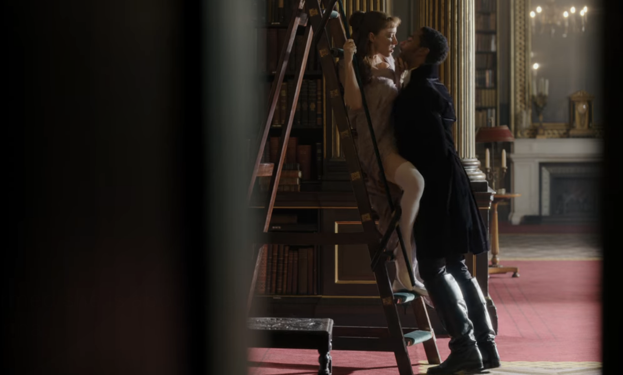 """Simon and Daphne having sex on a ladder in a library in """"Bridgerton"""" episode 6"""
