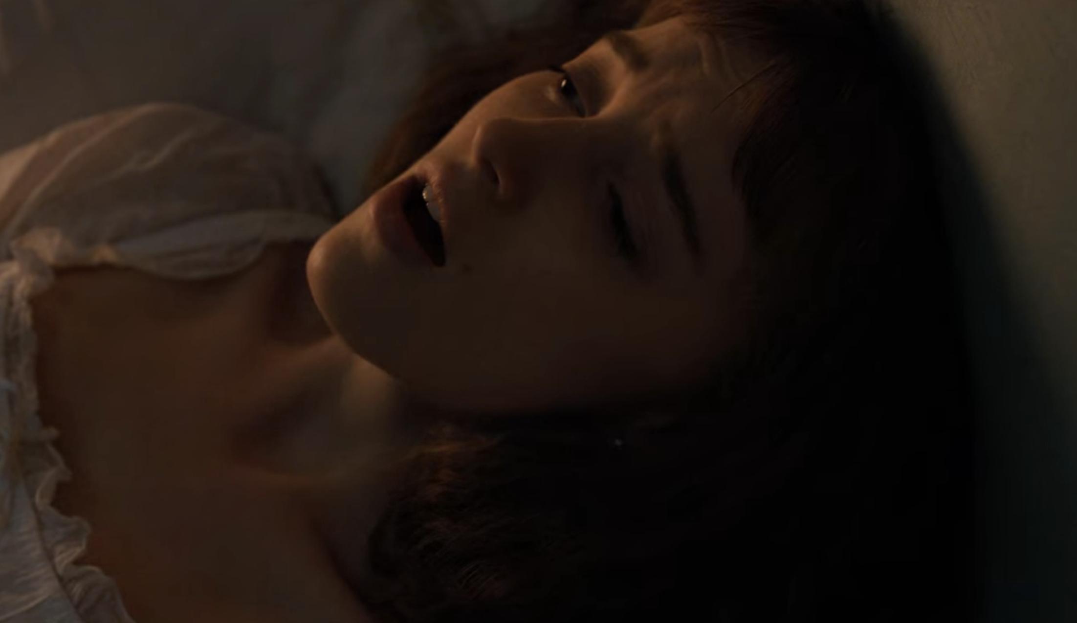Daphne in bed during the masturbation scene