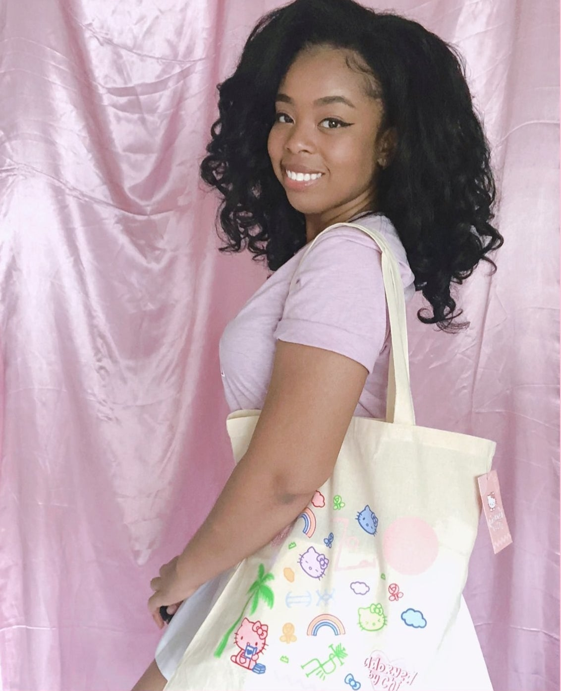 a model wearing the tote bag on their shoulder