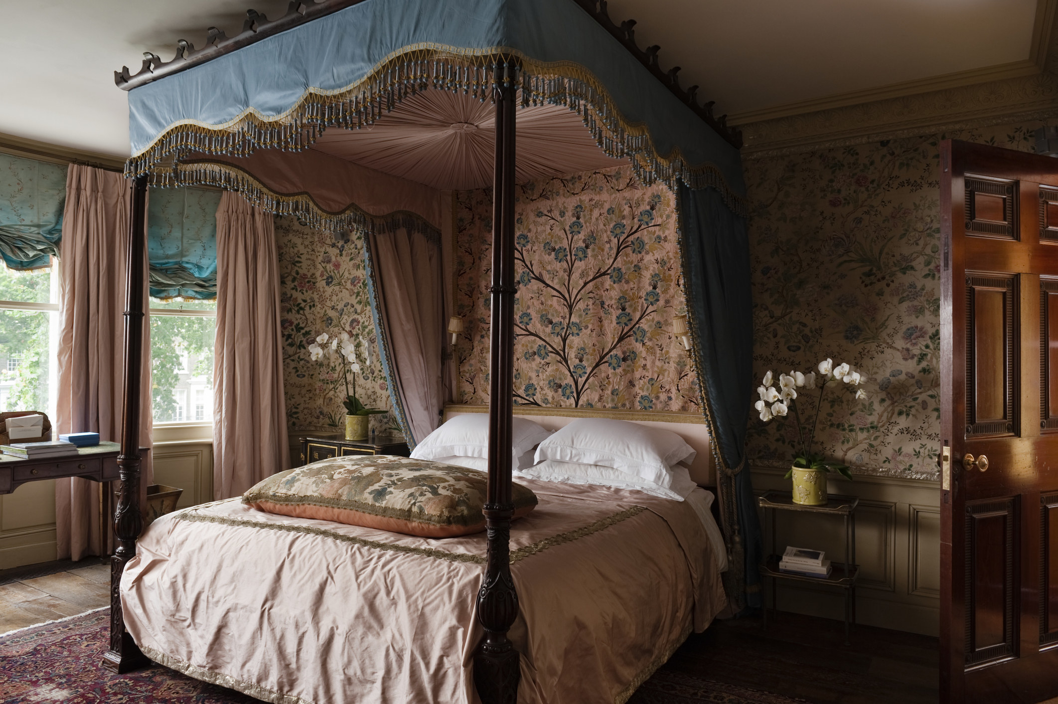 A four-poster bed in a a London apartment styled in the Georgian period