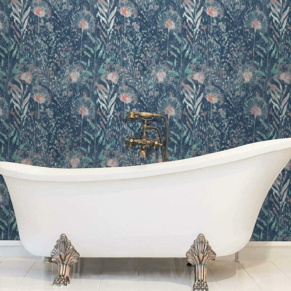 the floral wallpaper in red and blue behind a bath tub