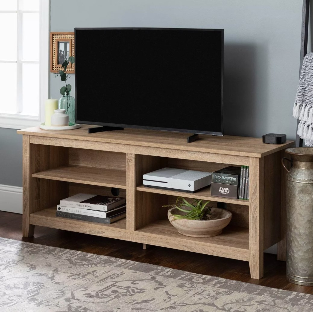 A wooden TV stand with 4 shelves