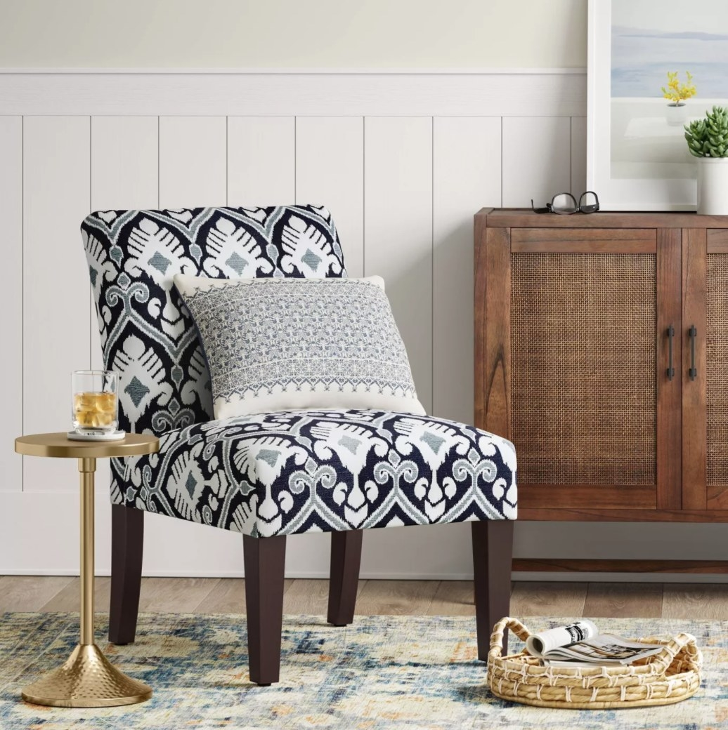 A black, gray, and white patterned armless accent chair