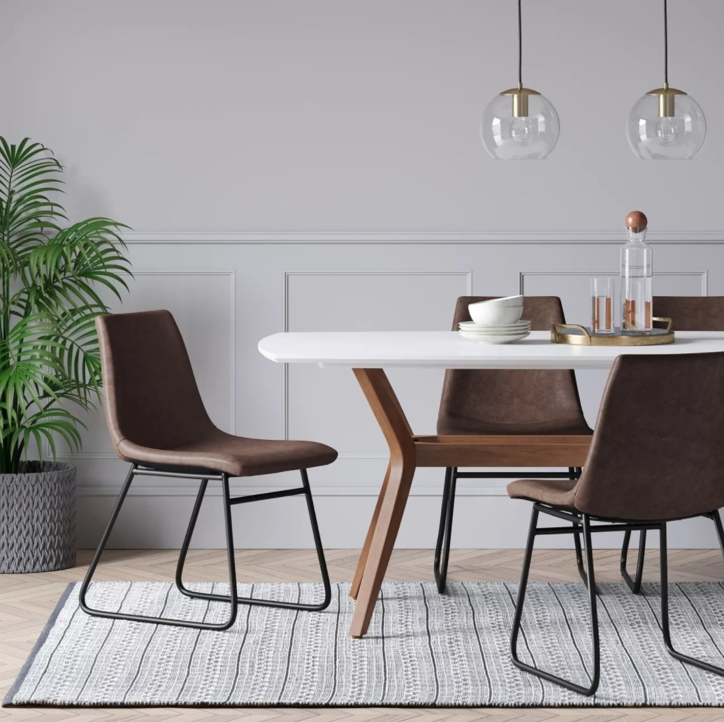 Brown faux leather dining chairs with black metal legs