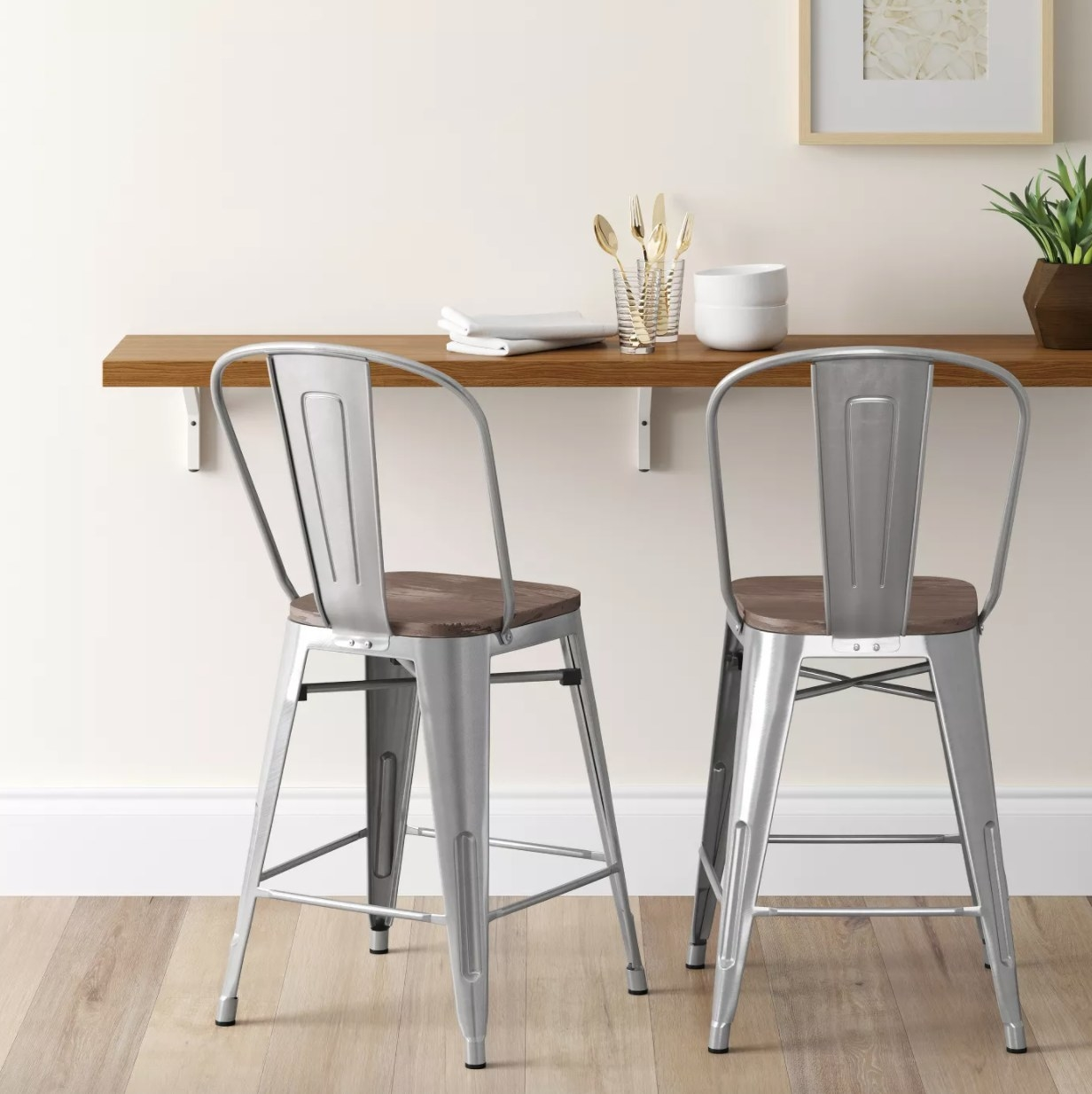 Metal barstools with wooden seats and metal backrests