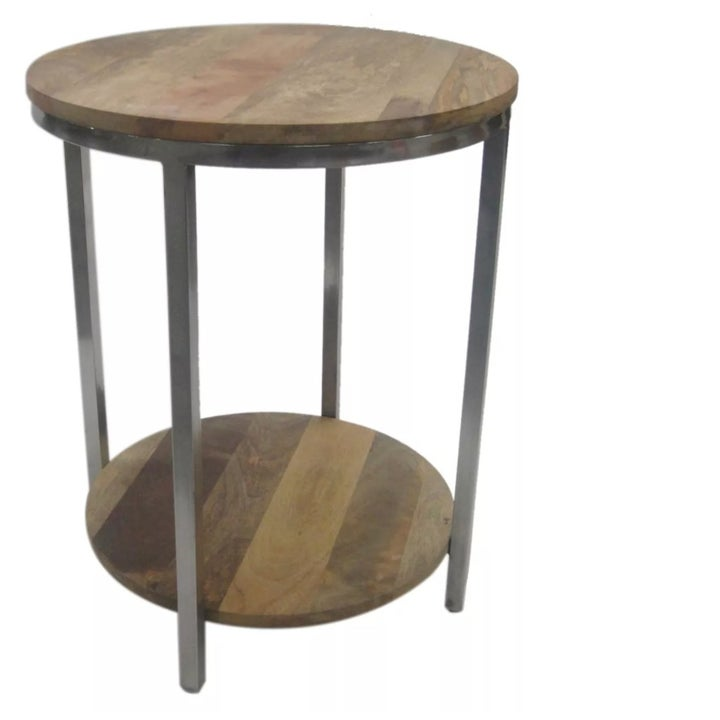 A round side table with lower shelf, wooden top, and metal frame